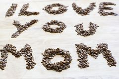 I love you Mom  from the seeds. Seeds of flax making tittle I love you Mom Stock Photography