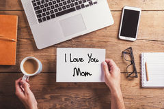 I love you mom sign. Studio shot, wooden background. Stock Photo