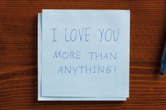 I love you more than anything written on a note Royalty Free Stock Photo