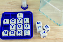 I LOVE YOU MORE on Wording Game Stock Image