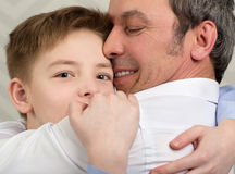 I love you so much, Dad. Close-up shot of a son giving father a hug. Boy devoted to his beloved dad stock image
