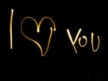 I love you note. I love you written in gold on black background Royalty Free Stock Photography