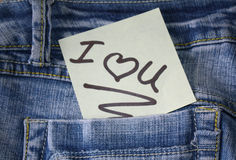I love you note with a heart. I love you note on post it paper on jeans pocket stock images