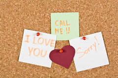 I Love You Note pinned to a cork memory bulletin board. I Love You, call me and sorry note pinned to a cork memory bulletin board Royalty Free Stock Photo
