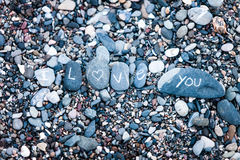 I Love You note on rocks Stock Photography