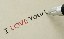 I love you note - Writing on a yellow paper Stock Image