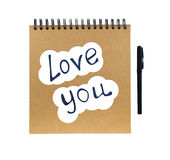 I love you and notebook with pen Royalty Free Stock Photo