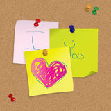 I Love You - original valentine card. Hand written post-it note on cork board Royalty Free Stock Image