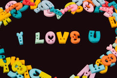 I love you phrase written by plastic colorful letters on blackboard. Royalty Free Stock Photos