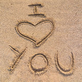 I love you. In the picture an inscription on the sand I love you stock photo