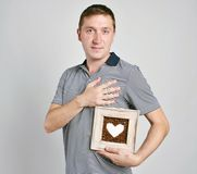 I love you!Portrait of a handsome man with heart Stock Images