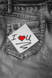 I love you post-it note with a red heart. I love you note on post it paper on denim Stock Photo