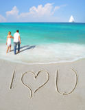 I Love You in Sand by Couple Royalty Free Stock Images