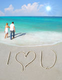 I Love You in Sand by Couple Stock Images