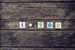I love you sign assembled of coloured letters and heart made of Stock Photography