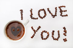 I love you sign with coffee beans and cup of coffee over white b. Ackground Stock Photo