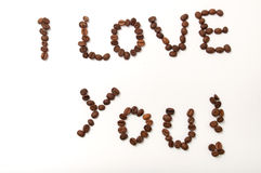 I love you sign with coffee beans over white background.  Royalty Free Stock Photography
