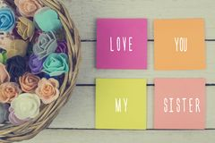 I love you sister. Toned. I love you sister text written on paper sticky notes. Toned royalty free stock images