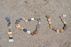 I love you spelled with pebbles on beach Stock Photos