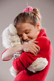I love you teddy bear. Littele girl loves his teddybear and gives it a hug stock image