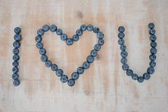I love you text, build with blueberries on wooden background Royalty Free Stock Photo