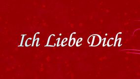 I Love You text in German Ich Liebe Dich formed from dust and turns to dust horizontally on red background stock video footage