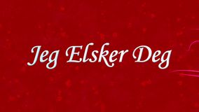I Love You text in Norwegian Jeg Elsker Deg formed from dust and turns to dust horizontally on red background stock footage