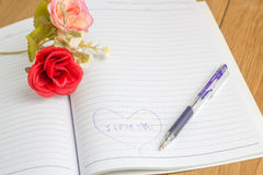 I love you text in notebook with pen and fake flower Stock Images