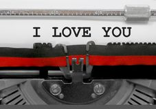 I LOVE YOU text by the old typewriter on white paper Stock Photo