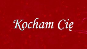 I Love You text in Polish Kocham Cie formed from dust and turns to dust horizontally on red background stock video