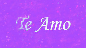 I Love You text in Portuguese and Spanish Te Amo turns to dust from left on purple background Stock Images