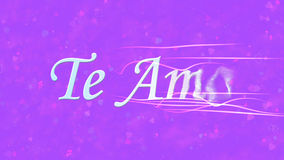 I Love You text in Portuguese and Spanish Te Amo turns to dust from right on purple background Royalty Free Stock Photography