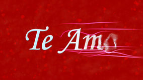 I Love You text in Portuguese and Spanish Te Amo turns to dust from right on red background Stock Photos