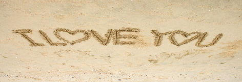 I love you text on sand Royalty Free Stock Photography