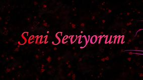 I Love You text in Turkish Seni Seviyorum formed from dust and turns to dust horizontally on dark background stock video