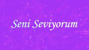 I Love You text in Turkish Seni Seviyorum formed from dust and turns to dust horizontally on purple background stock video