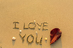 I Love You - text written on sandy beach. Abstract. Stock Image