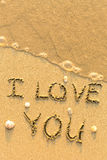 I Love You - text written on sandy beach Stock Photography