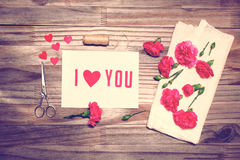 I Love You theme with scissors, twine, and carnation flowers Royalty Free Stock Image