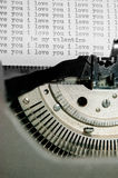 I love you and valentines message type on old typewriter. I love you typed over and over and over again on an old type writer with a valentines message embedded Stock Image