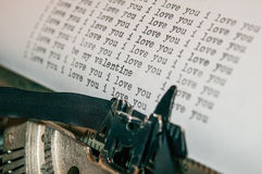 I love you and valentines message type on old typewriter. I love you typed over and over and over again on an old type writer with a valentines message embedded Royalty Free Stock Photo