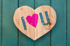 I love You Valentines message wooden heart on turquoise painted Royalty Free Stock Photos