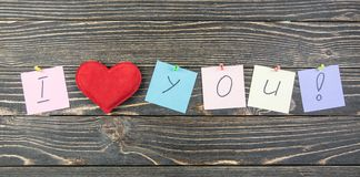 I love you on wood background.  Stock Photography
