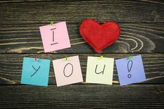 I love you on wood background.  Stock Images