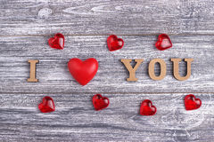 I love you, wooden lettering, gray background, postcard Happy Valentine day, flat lay Stock Photos