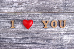 I love you, wooden lettering, gray  background, postcard Happy Valentine day, flat lay Royalty Free Stock Images
