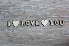 I love you wooden shape heart and letters, love theme. Royalty Free Stock Image
