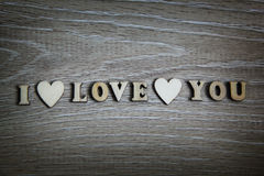 I love you wooden shape heart and letters, love theme. Royalty Free Stock Photography