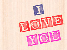 I love you, words stamped on wooden Stock Image
