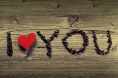 I love you written with brown coffee-beans Royalty Free Stock Photos